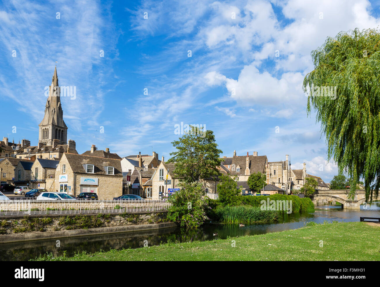 The spire of St Mary's Church from the Meadows, Stamford, Lincolnshire, England, UK - Stock Image