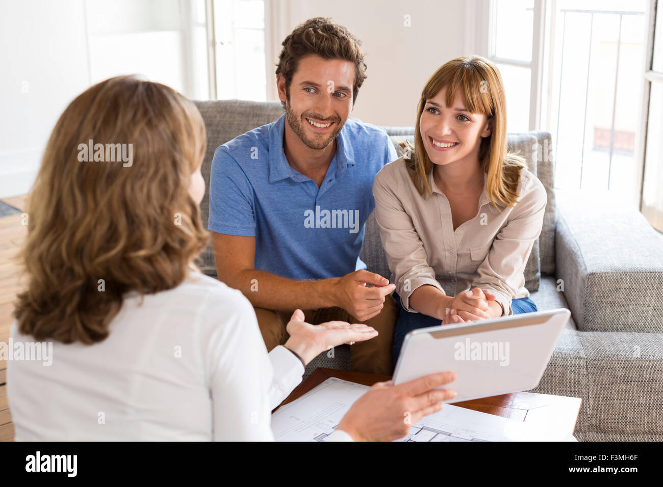 Saleswoman presenting a new project property on digital tablet - Stock Image