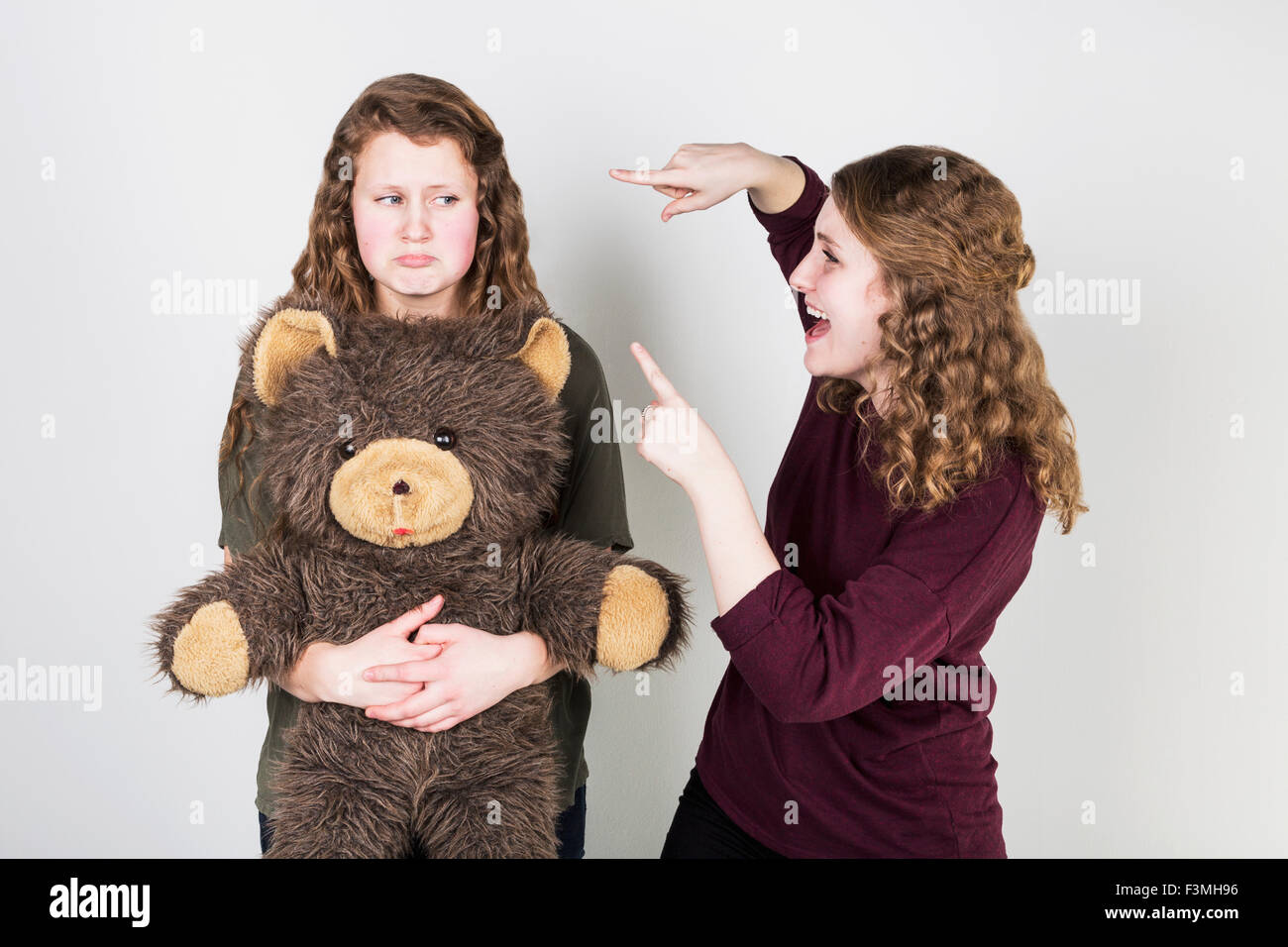 Girlfriends,Bullying,Teddy Bear,Sneering Stock Photo