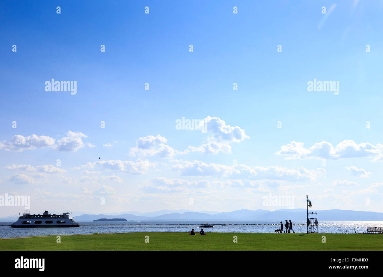 Waterfront Park on Lake Champlain with Ferry to Port Kent , Burlington, Vermont, USA - Stock Image
