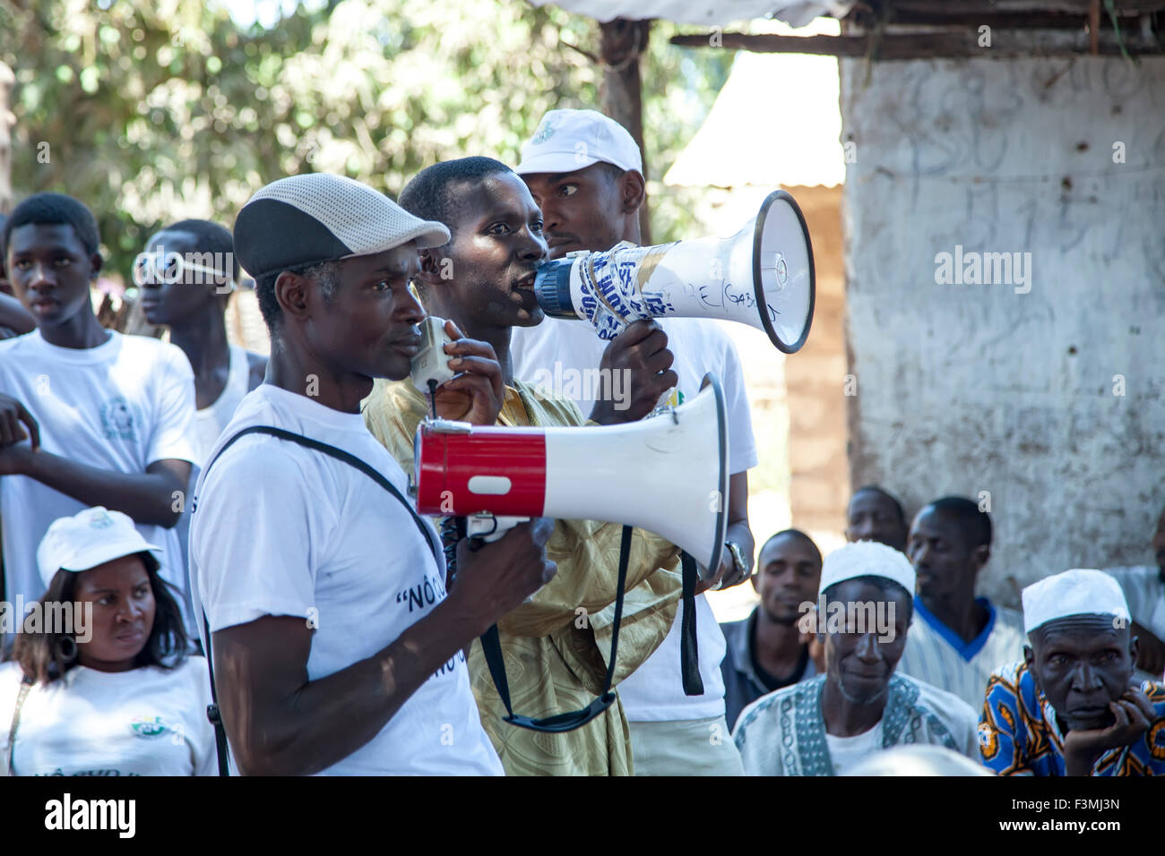 African NGO activists delivering a public lesson to village elders in rural Guinea-Bissau - Stock Image