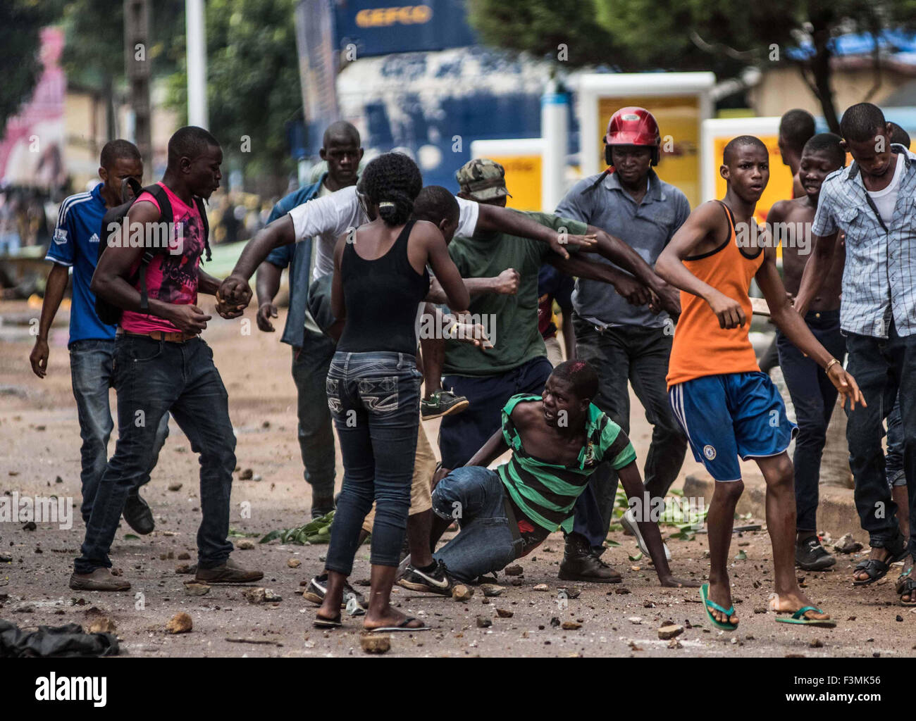 A man is beaten up during political violence in Conakry, Guinea, ahead of  elections in 2010.