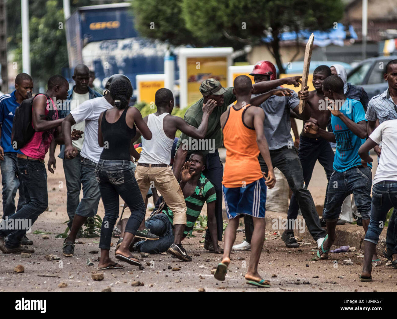 A man is beaten up during political violence in Conakry, Guinea ahead of  elections in 2010.