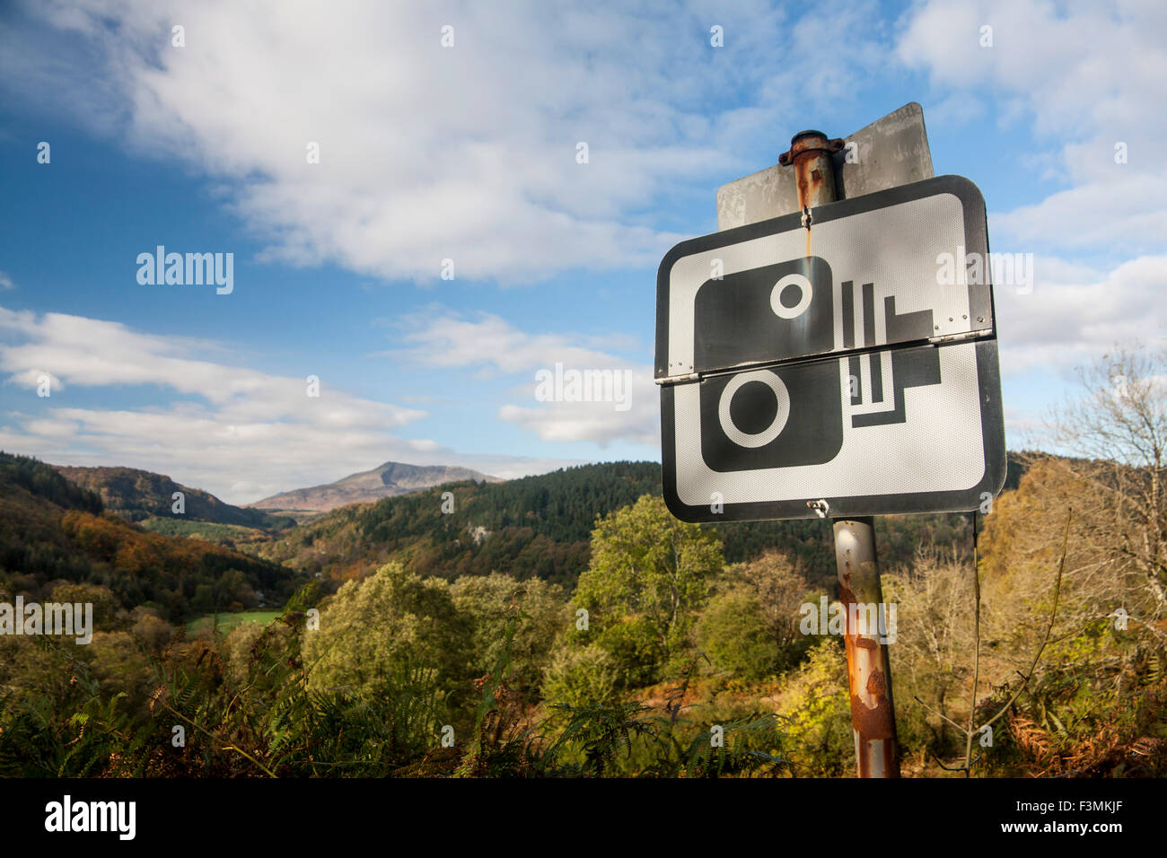 Speed camera sign with Moel Siabod mountain Snowdonia in background on A5 near Betws-y-Coed North Wales UK - Stock Image