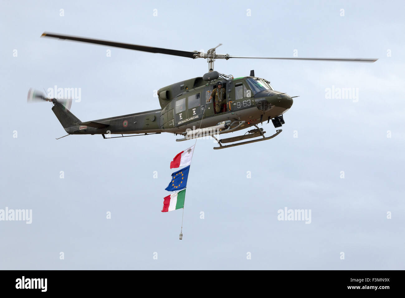 Italian Agusta Bell AB-212 flying the flags of Malta, Europe and Italy. Stock Photo