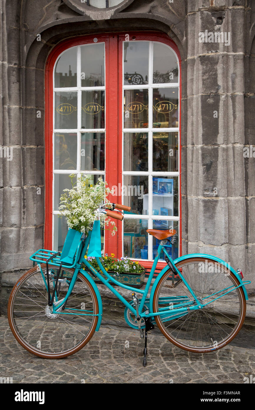 Bicycle parked outside a shop window in Bruges, Belgium - Stock Image