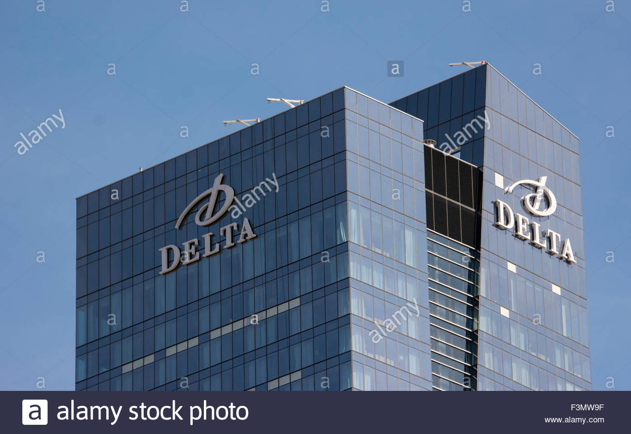 The logo Delta on the facade of a modern skyscraper. The SouthCore Financial Centre is a new building located in - Stock Image