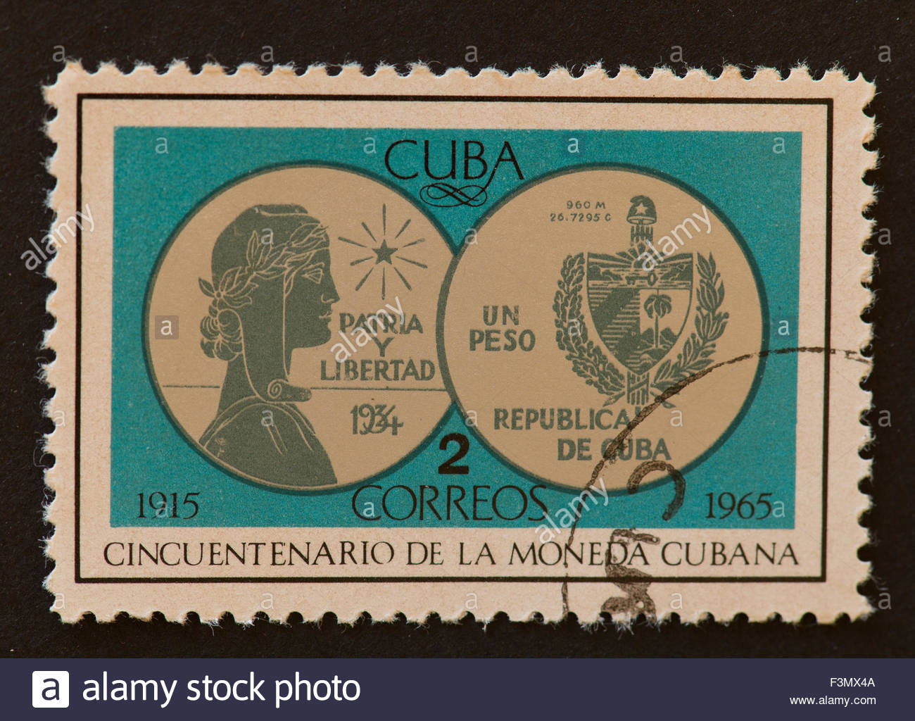 Cuban postage stamp: celebrating the fiftieth or 50th anniversary of the Cuban money or currency. - Stock Image