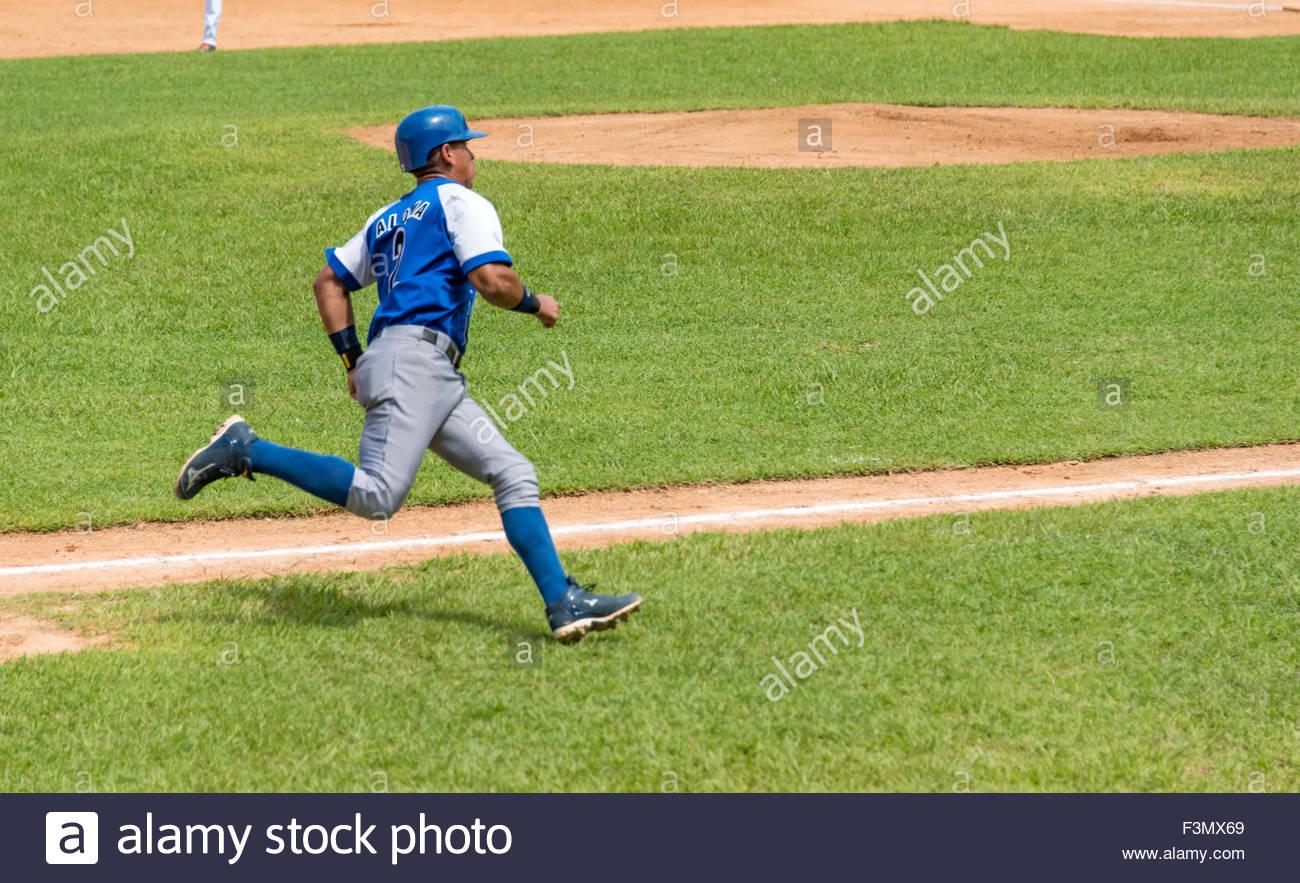 cuban baseball, team Industriales vs Villa Clara, JORGE ENRIQUE ALOMA HERRERA scores a run - Stock Image