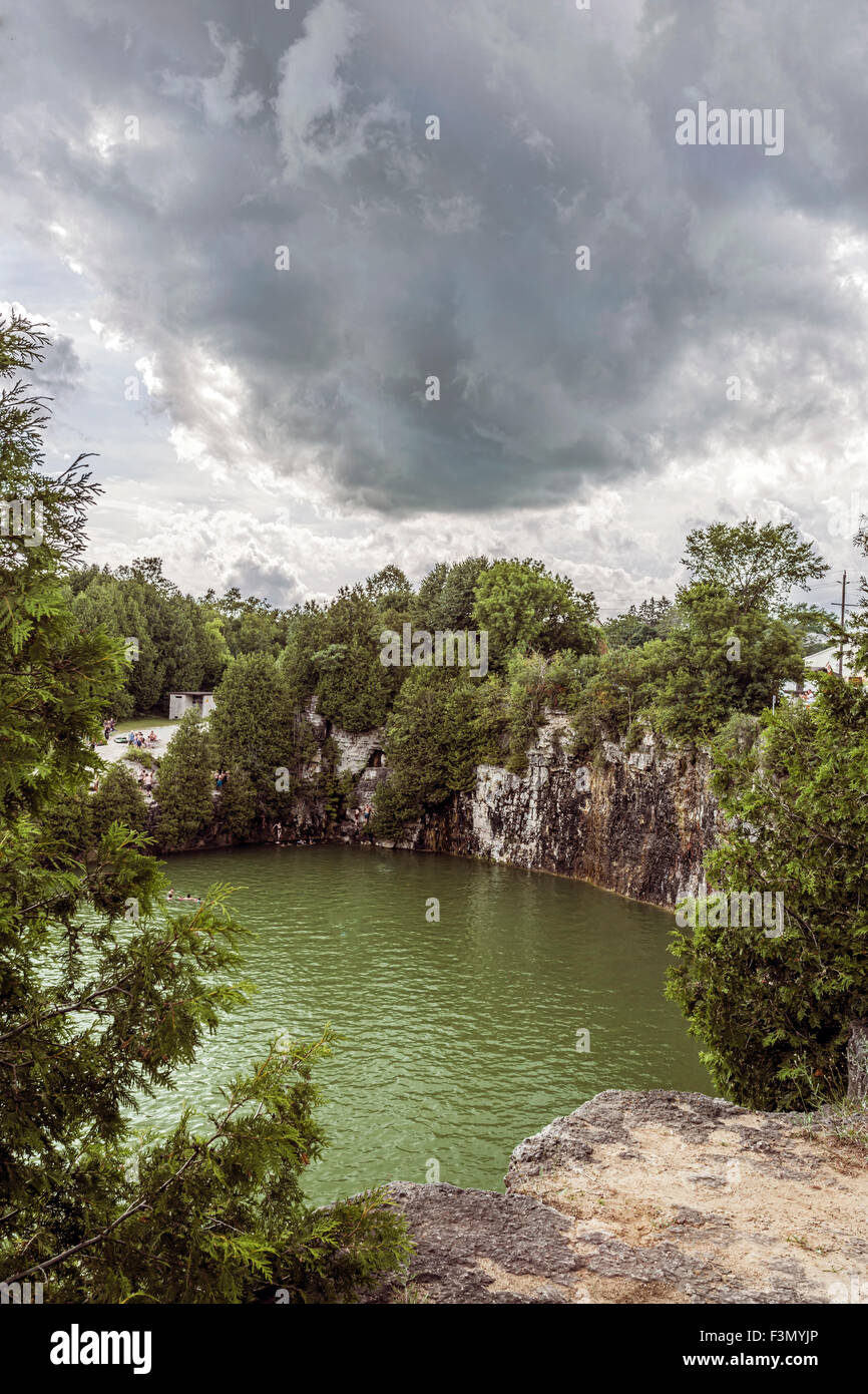 Elora Quarry on a hot summer day with strange cloud above. - Stock Image