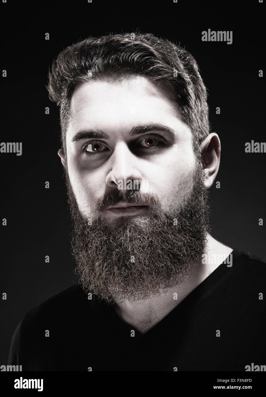 Portrait of a Teenage Hipster with Beard - Stock Image