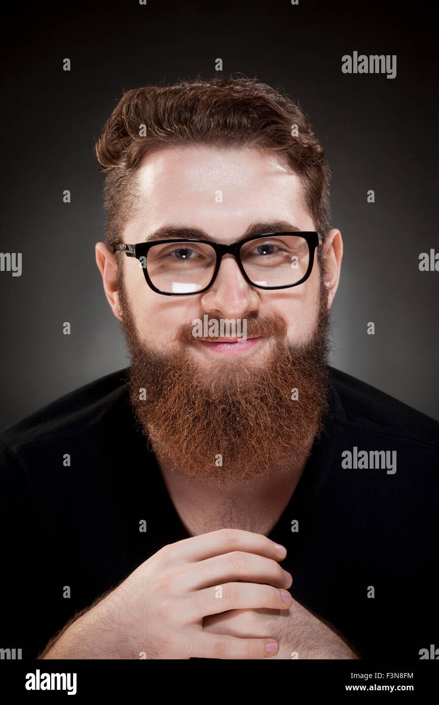 Portrait of a Teenage Hipster with Beard and Glasses - Stock Image