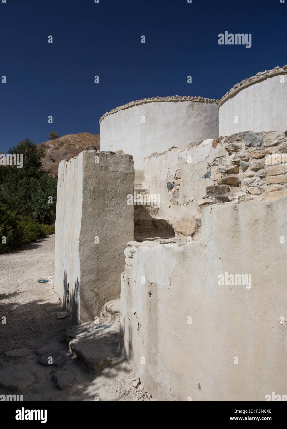 Reconstruction of the protected entrance and houses at the  Neolithic settlement of Choirokoitia in Cyprus Stock Photo