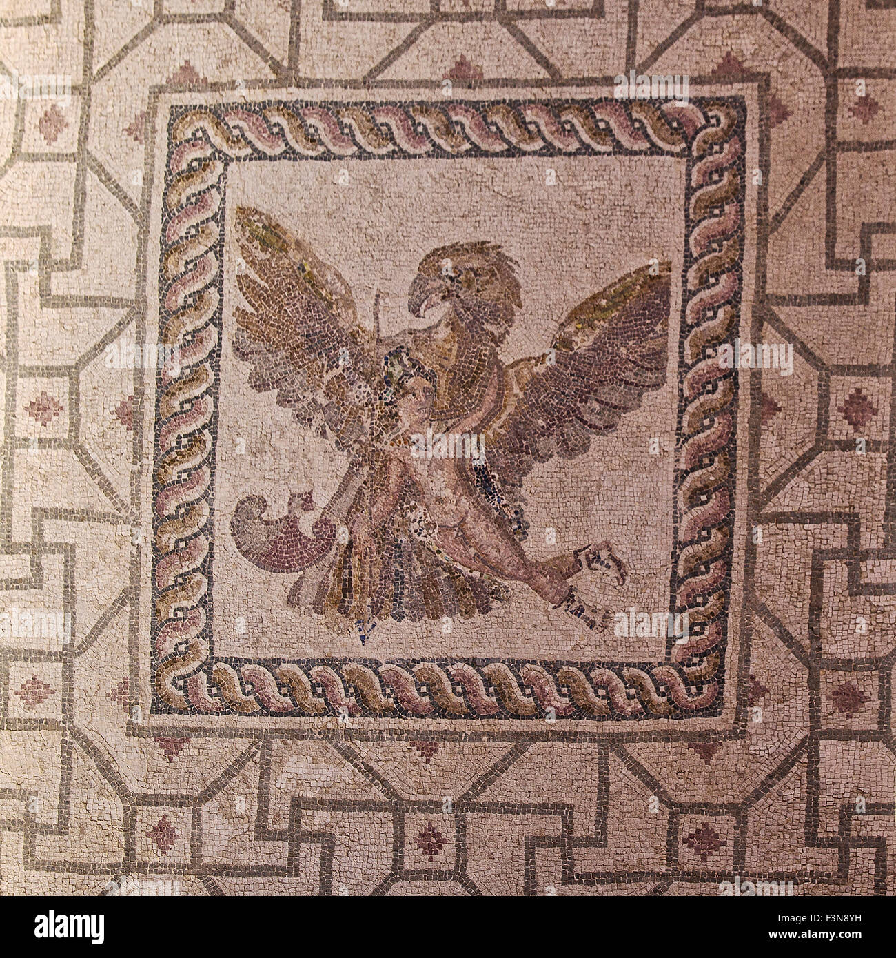 The mosaic of Zeus abducting Ganymede in the House of Dionysos in the Paphos Archaeological Park in Cyprus - Stock Image