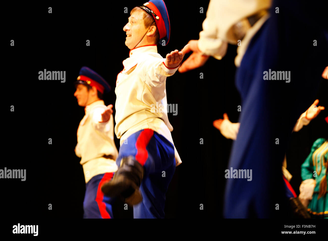 Russian Cossack folk tradition dancers performing live on stage during an entertainment evening show in Myrina city, - Stock Image