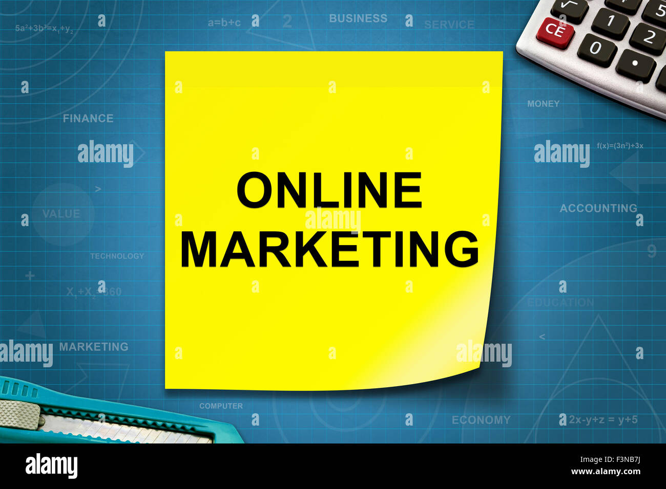 online marketing text on yellow note with graph paper stock photo