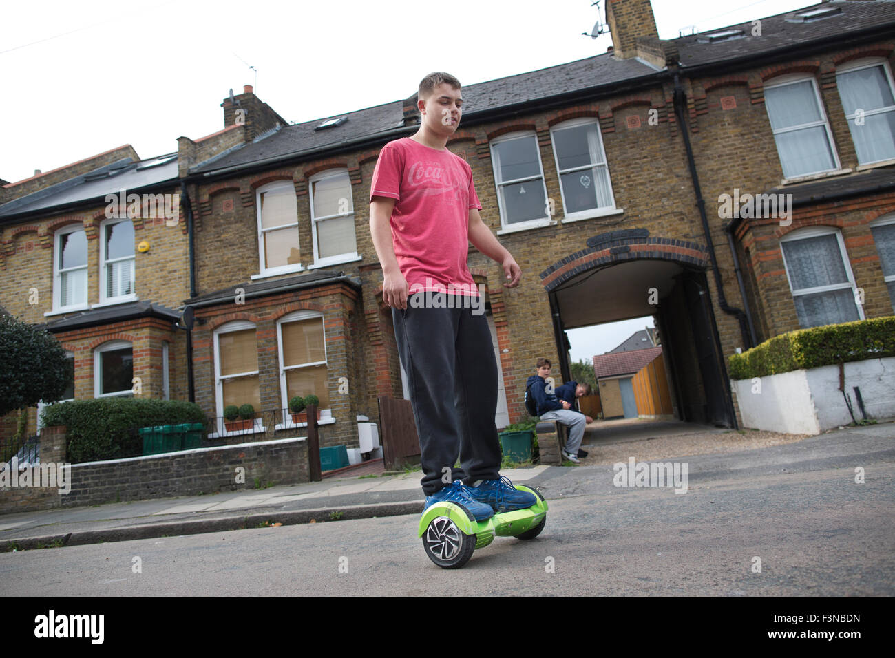 'Hoverboard' scooters being ridden by teenage boys, London, England, UK - Stock Image