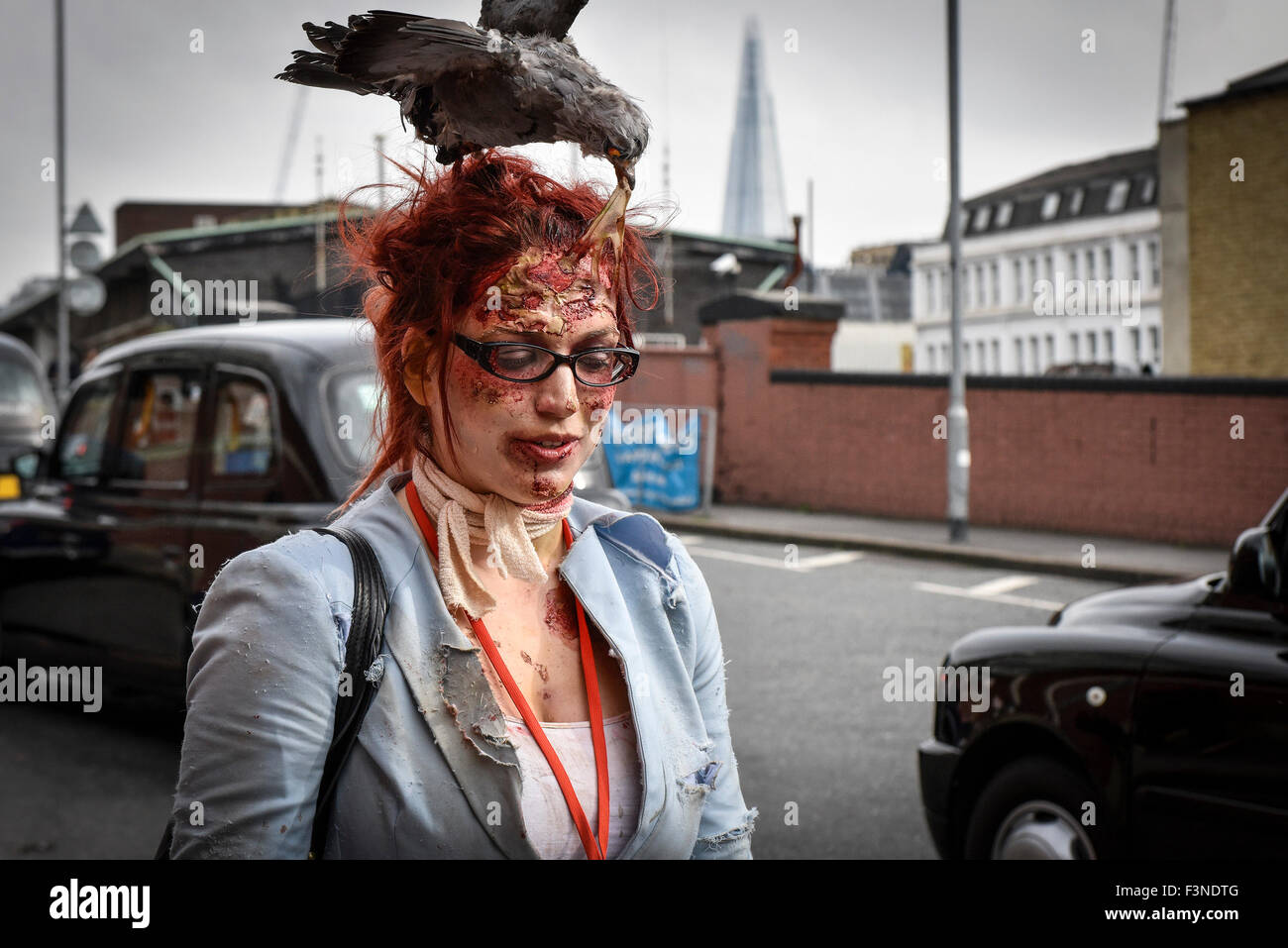 Waterloo, London. 10th October, 2015.  A zombie with a bird on her head joins her undead friends in preparation - Stock Image