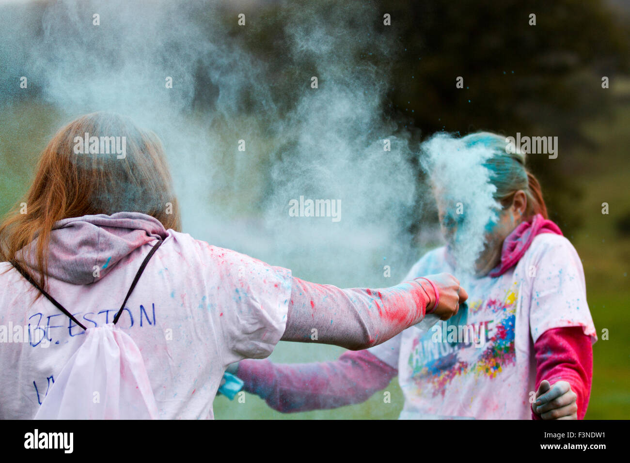 The world's most colourful 5k, 'Run or Dye'  at Chatsworth this autumn. As runners, walk, dance through the - Stock Image