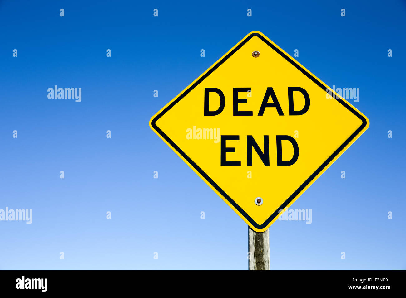 7b376a1d2d9d0 Photograph of a yellow Dead End sign shot against a clear blue sky. Sign is