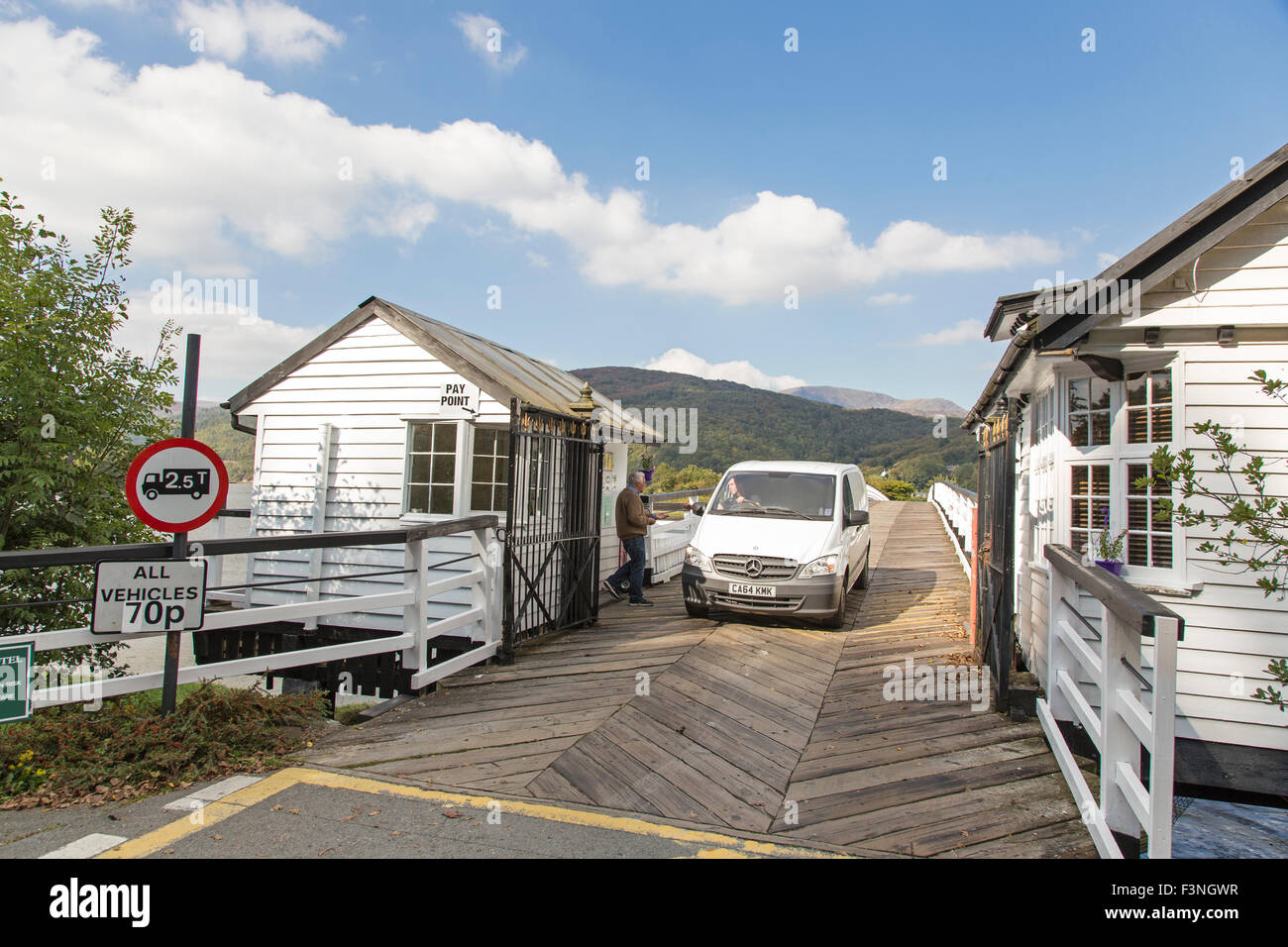 Penmaenpool wooden toll bridge crossing the River Mawddach, Snowdonia National Park, Gwynedd, North Wales, UK - Stock Image