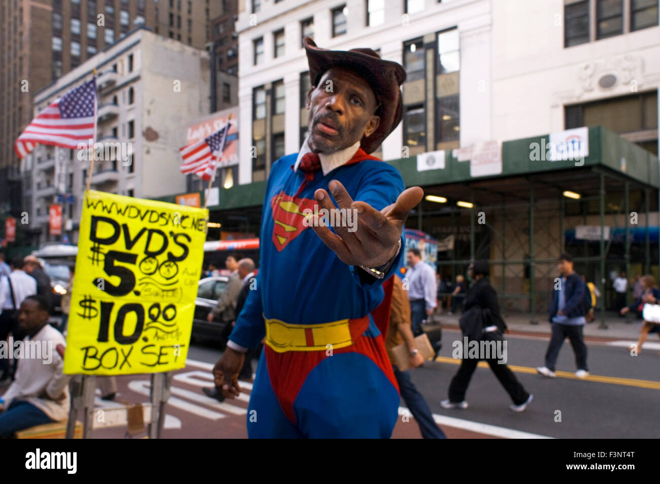 A man dressed as Superman tries to be photographed with tourists in Chelsea to make a little money. This is a neighborhood - Stock Image