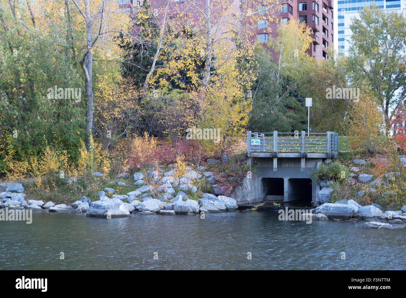 Stormwater outfall, the exit point from the Calgary's storm drainage system through an underground pipe system - Stock Image