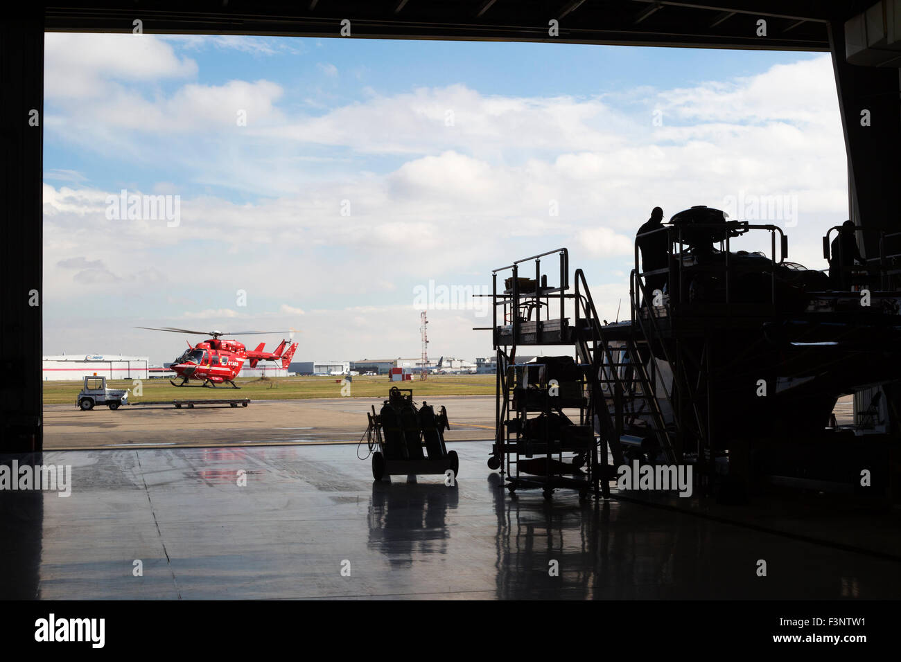 STARS air ambulance helicopter taking off from hangar to respond to call from Children's Hospital - Stock Image