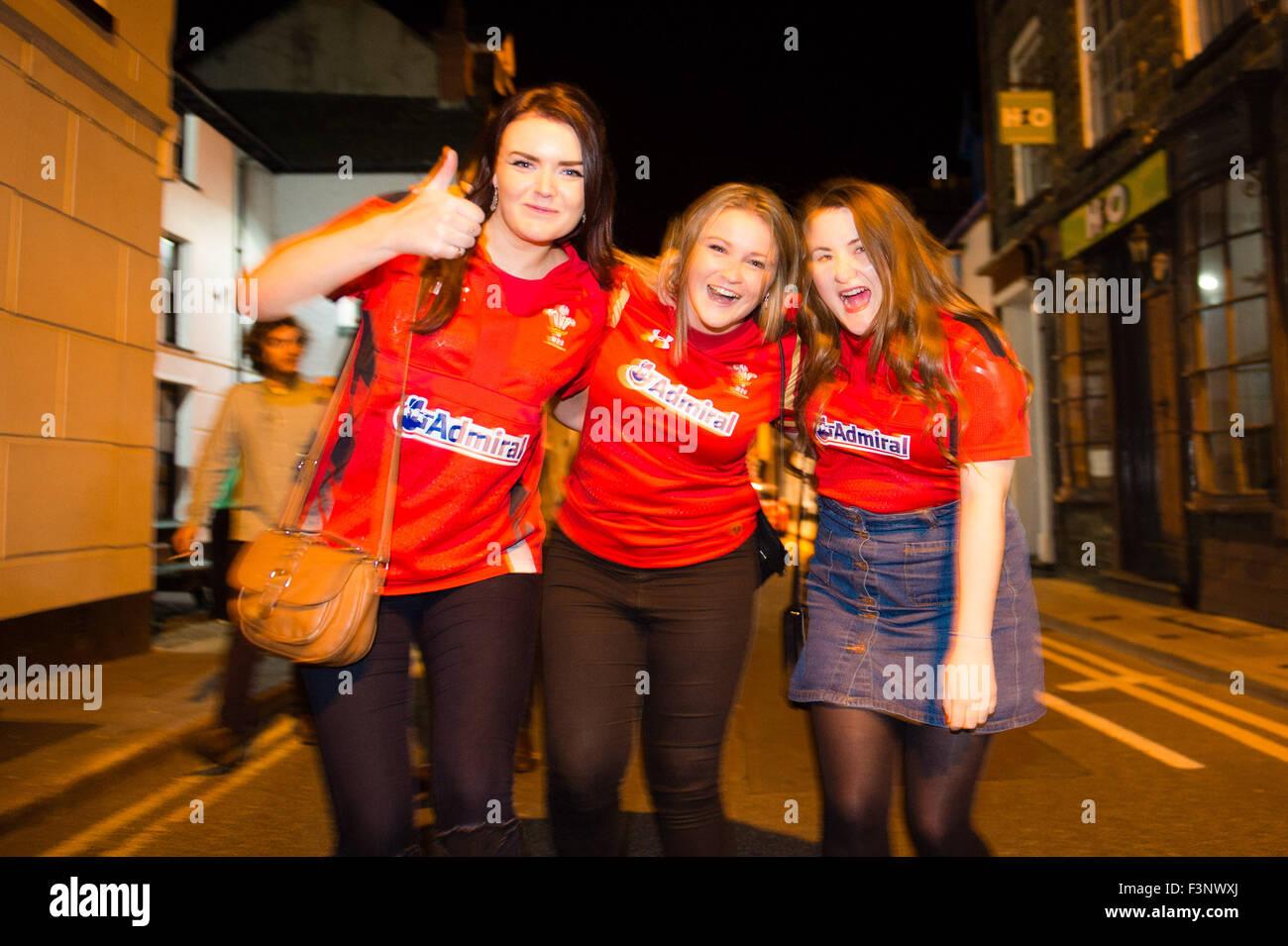 Aberystwyth Wales Uk, Saturday 10 October 2015  Three Welsh football  fans outside the Llew Du pub  Hotel in Aberystwyth - Stock Image