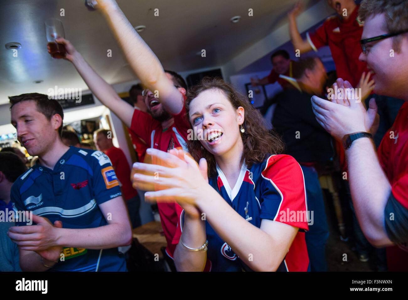 Aberystwyth Wales Uk, Saturday 10 October 2015  Welsh football  fans in the Llew Du pub  Hotel in Aberystwyth celebrate - Stock Image