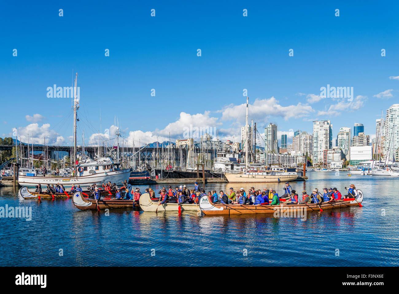 Canoes arrive at Fraser Fest, Vancouver, British Columbia, Canada, - Stock Image