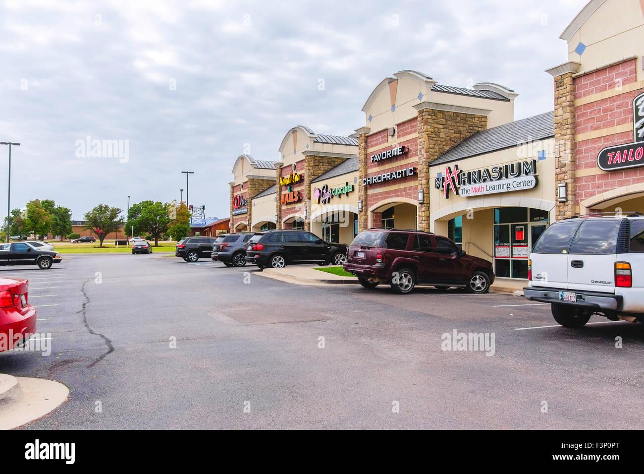 A strip mall exterior in Oklahoma City, Oklahoma, USA. - Stock Image
