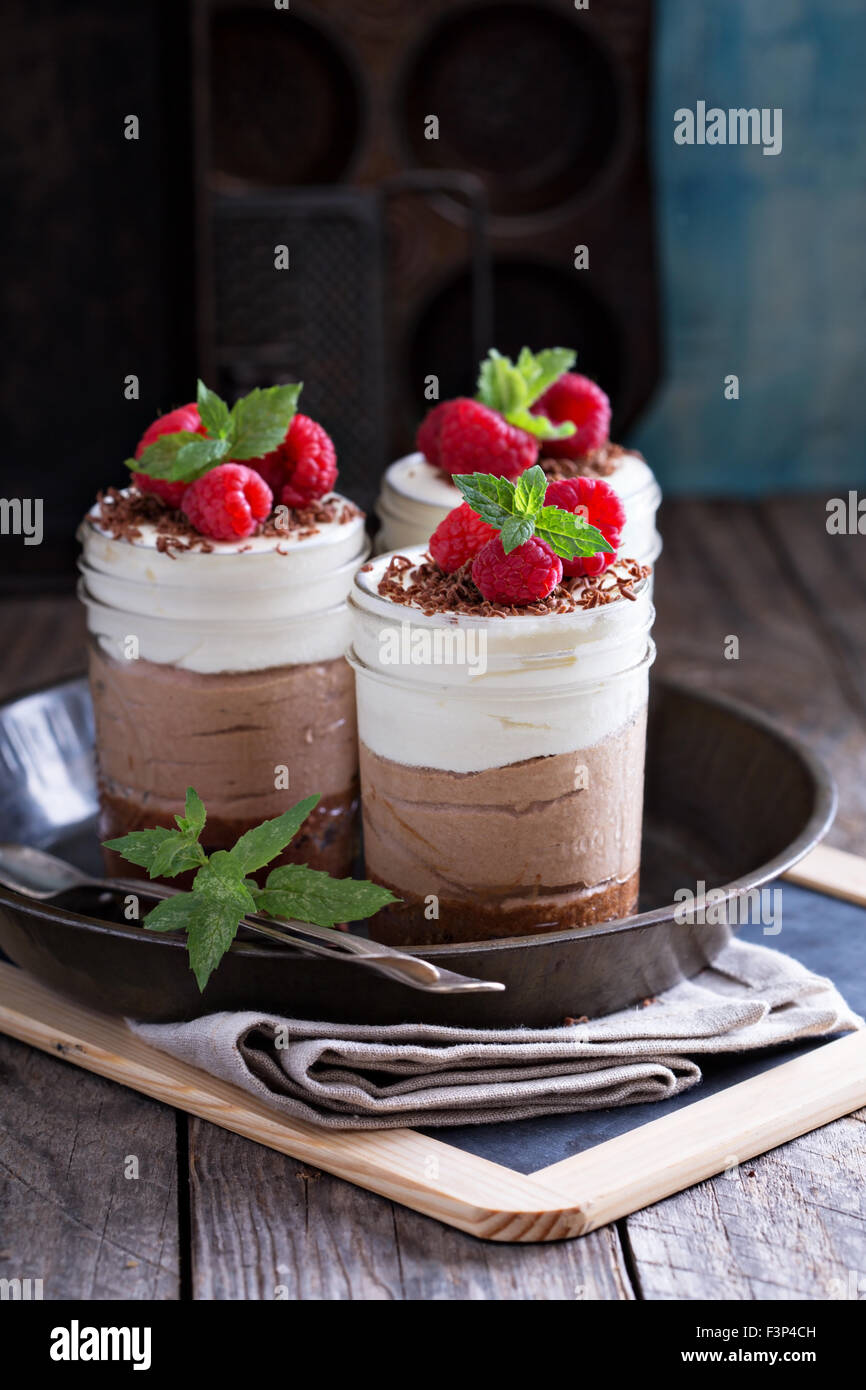 Three chocolate mousse dessert in mason jars - Stock Image