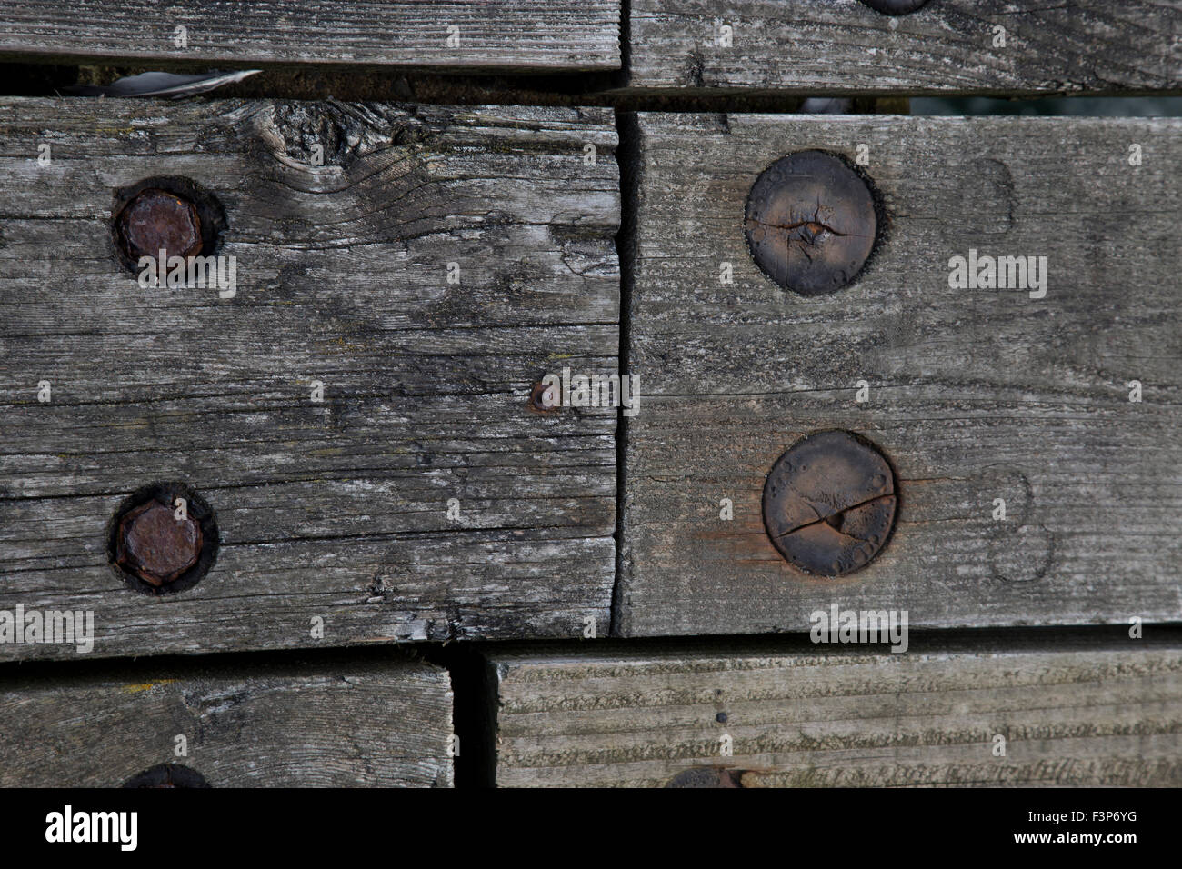 Wooden weathered boards held together with a mixture of metal and wooden fittings Stock Photo