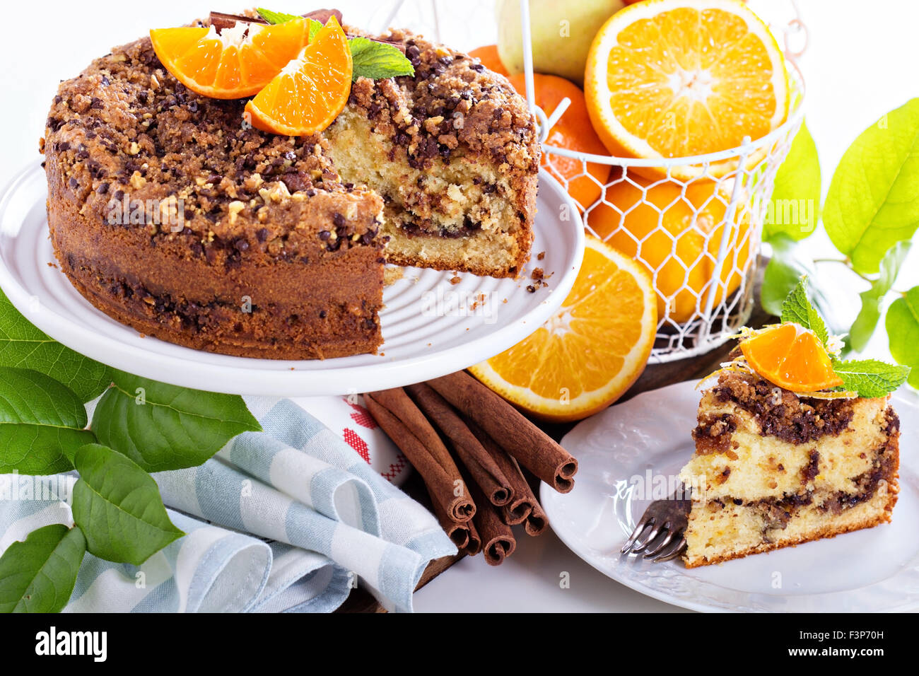 Coffee cake with oranges, nuts and chocolate with crumble topping - Stock Image