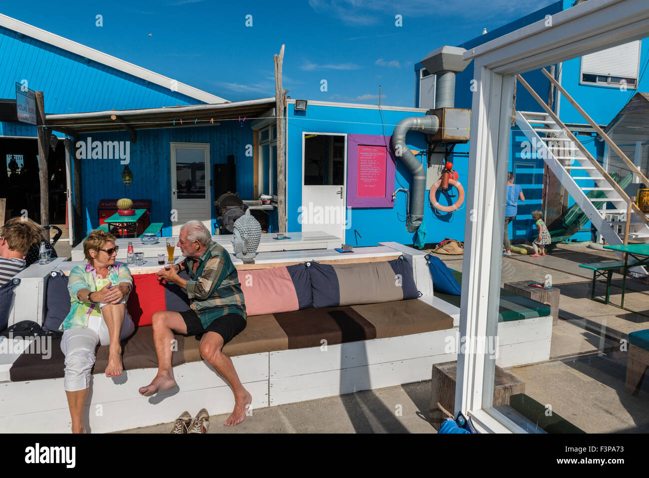 2 July, 2014  The Zandzee Bar at paal 11 at the Noordzee Beach is a colorful place with good food and drinks. The beach is very  Stock Photo