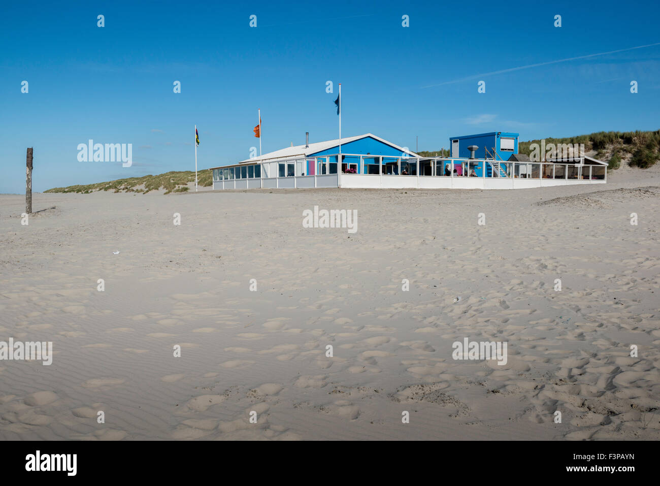 2 July 2014  The beach is very wide at The Zandzee Bar at paal 11 at the Noordzee Beach.  De Zandzeebar bij Paal - Stock Image