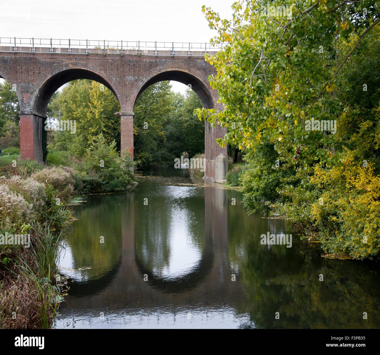 railway bridge over river cann , central park, chelmsford essex uk - Stock Image