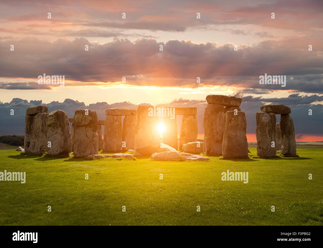 The sun setting over Stonehenge, Wiltshire, England. Stock Photo