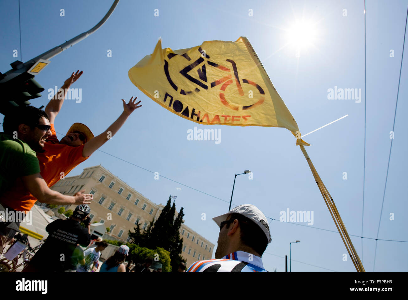 Cyclists wave a bicycle flag during their protest outside Greek Parliament. Syntagma sq., Central Athens, Greece. - Stock Image