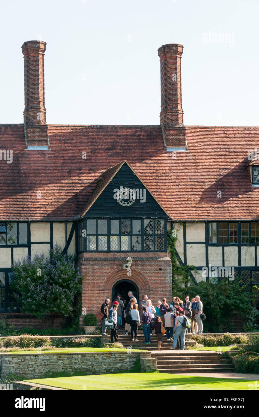 A tour group in front of the Grade II listed laboratory at the RHS gardens at Wisley in Surrey. - Stock Image