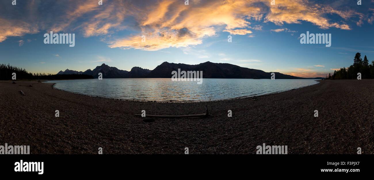 Wide panorama view at sunset view of Teton Range; Jackson Lake; Grand Teton National Park; Wyoming; USA - Stock Image