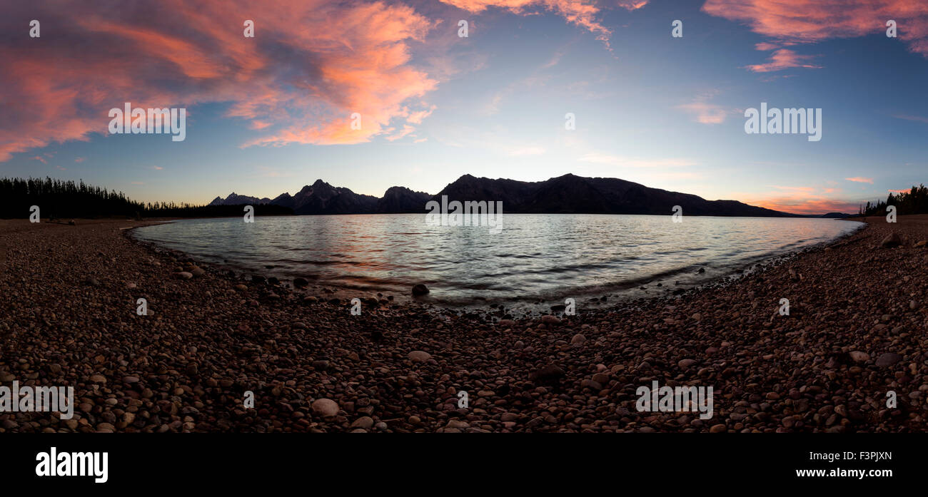 Wide panorama view at sunset view of Teton Range; Jackson Lake; Grand Teton National Park; Wyoming; USA - Stock Image