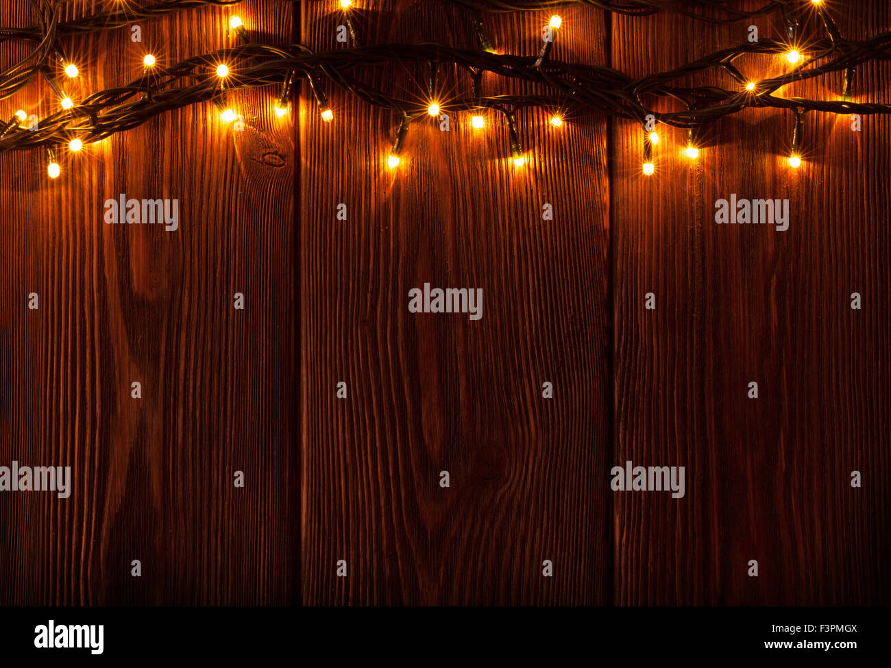 Christmas Lights On Wooden Background View With Copy Space