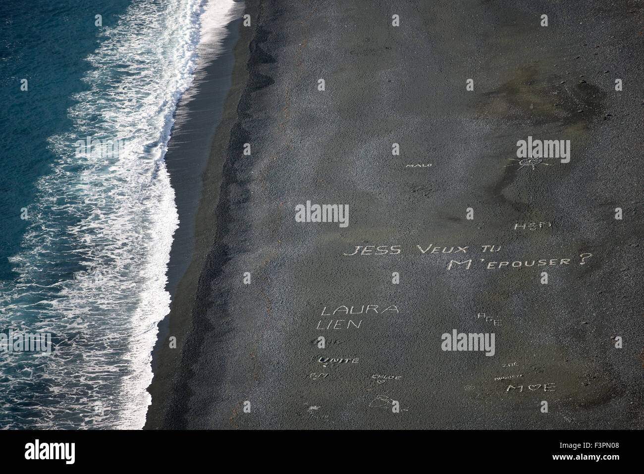 Designs and writings on the black beach, Nonza, Corsica, France - Stock Image