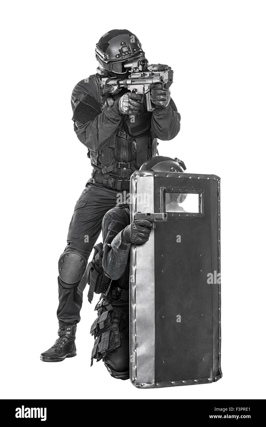 Spec ops police officer SWAT with ballistic shield studio shot - Stock Image