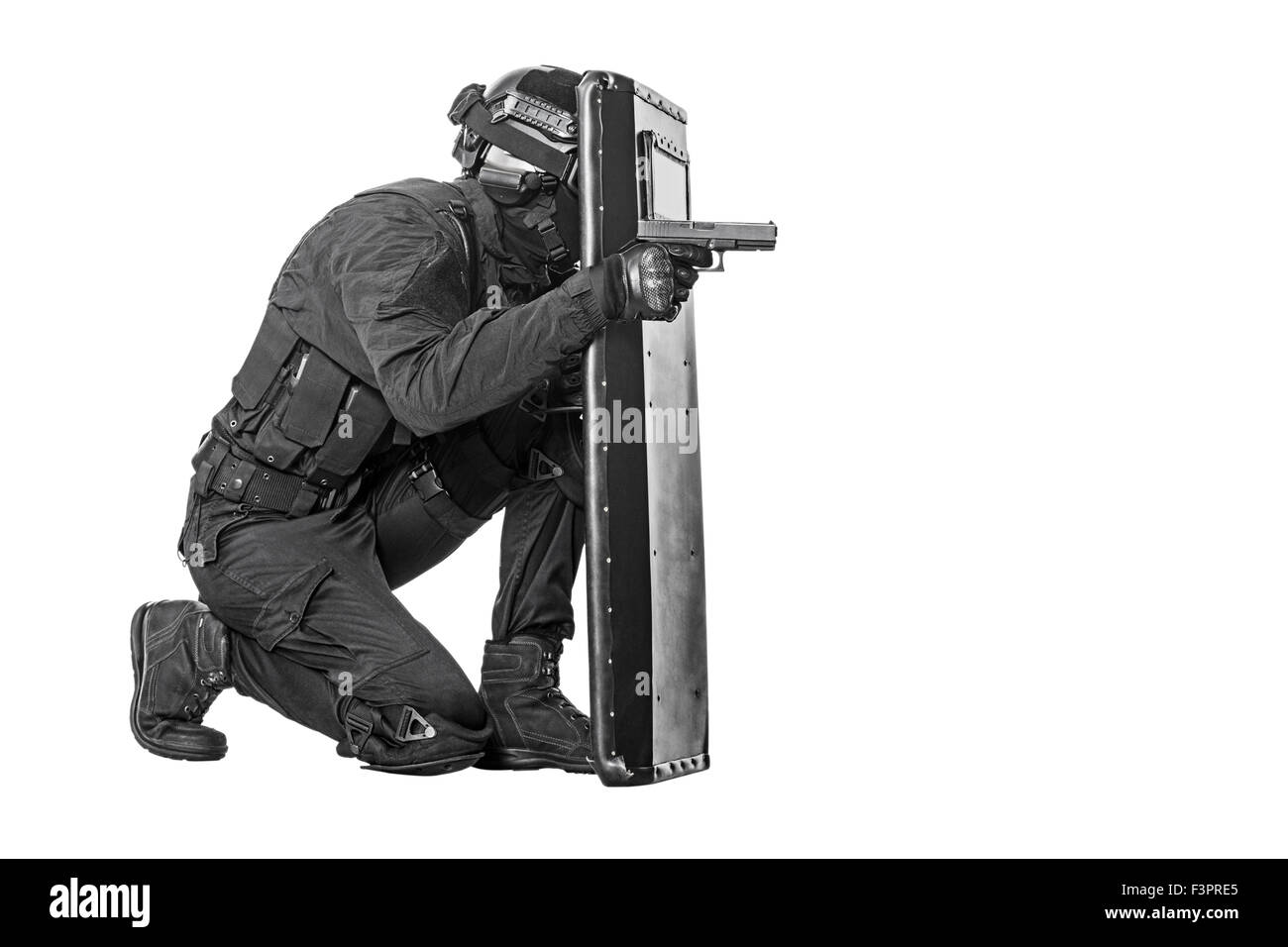 SWAT officer with ballistic shield - Stock Image