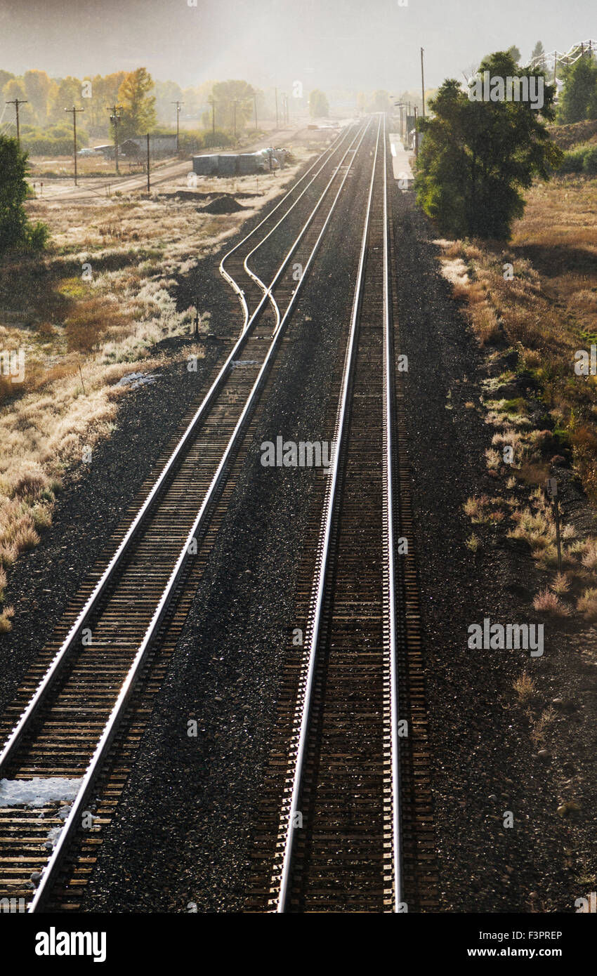 Sun and rain on railroad tracks; Granby; Colorado; USA - Stock Image