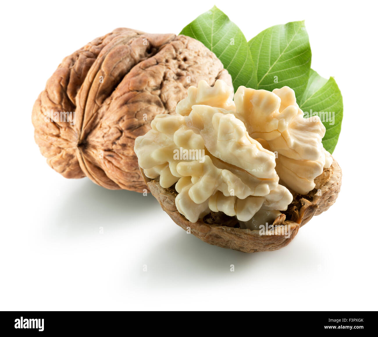 walnuts with leaves isolated on the white background. - Stock Image