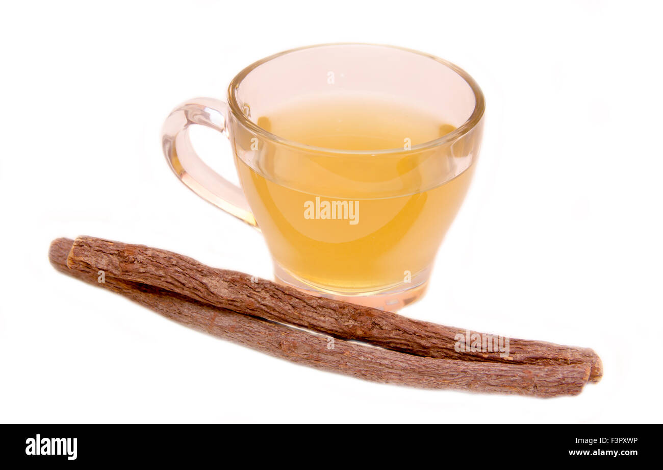 Herbal tea licorice in cup on white background - Stock Image
